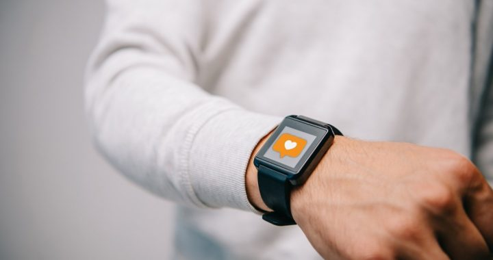 A man checking his smart watch