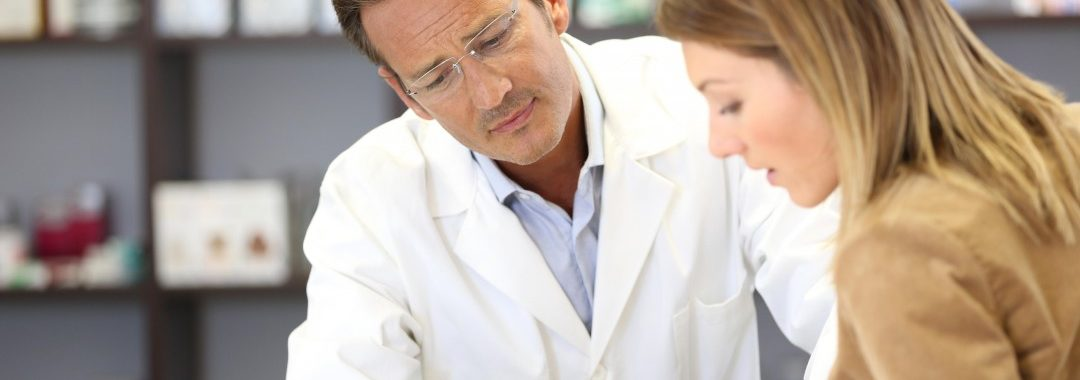 A doctor goes over medical information with his patient.