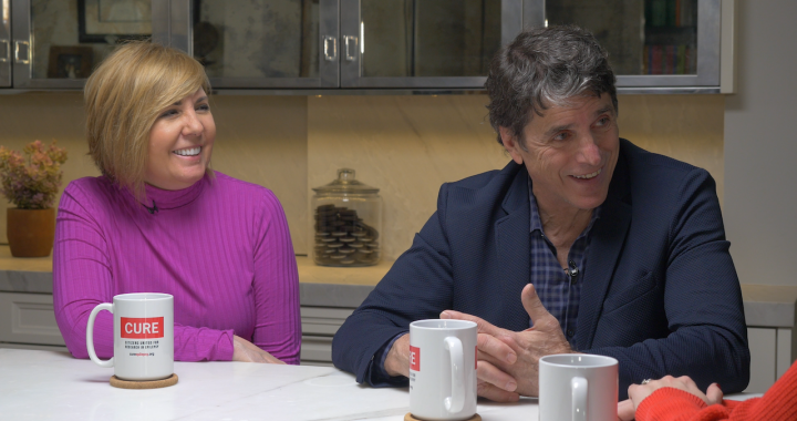 Mike and Kim Adamle smiling as they are being interviewed for an episode of Seizing Life, a CURE podcast