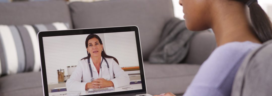 A woman is having a discussion via video chat with her doctor.